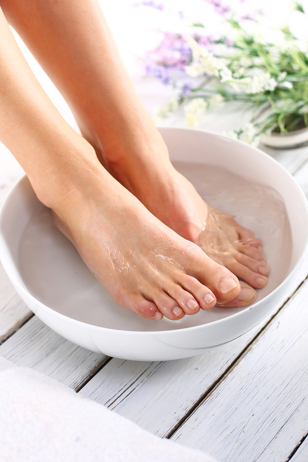 soak feet in warm water